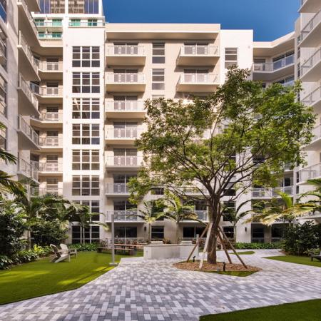 Outdoor Courytard with Grills | Modera Edgewater | Apartment Homes | Miami, Florida