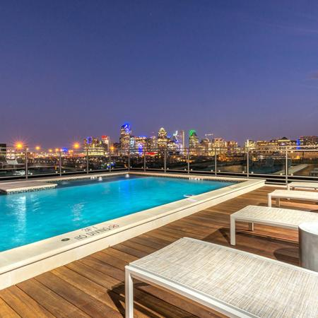 Rooftop lounge with sparkling pool overlooking the city
