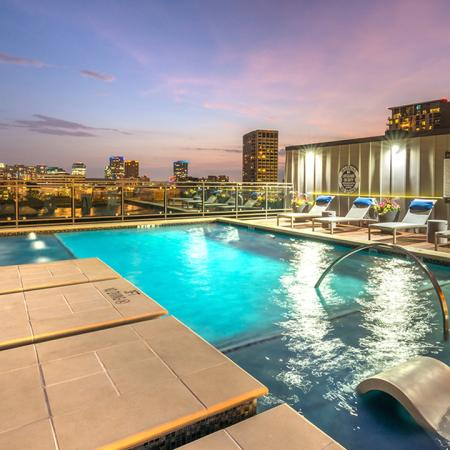 Resort Style Pool on Rooftop with Tanning Ledge during Twilight