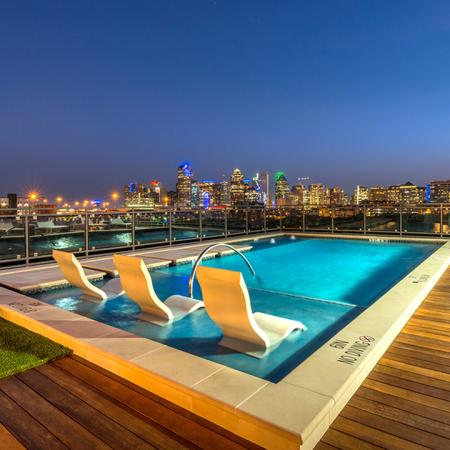 Stunning Dallas Views from Rooftop Lounge & Pool with Wooden Decking and Turf Areas