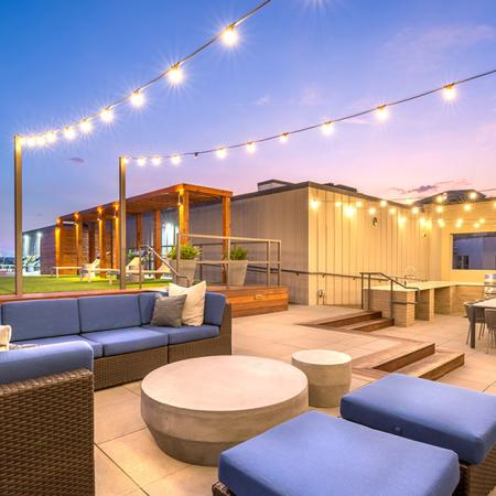 Outdoor Lounge with Bistro Lights and Dining Area with Twilight Lighting