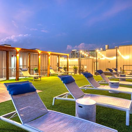 Roof Top Turf Area with Lounge Chairs and Ambient Lighting
