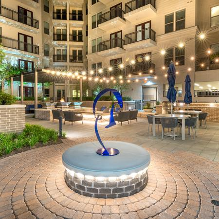 Paved Courtyard with Sleek Modern Sculpture & Dining Area