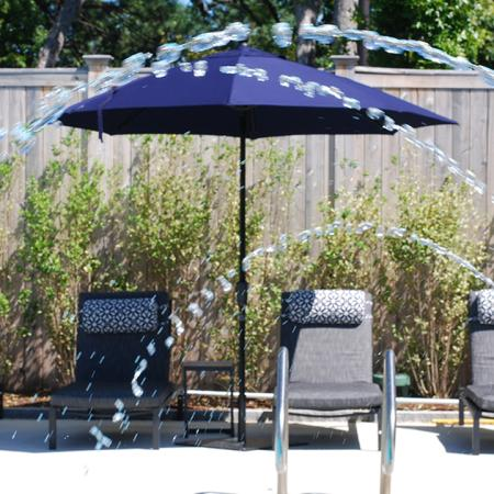 Pool-Side Deck Featuring Lounge Chairs and Shade Umbrellas | Modera Needham | Apartment Homes | Needham, MA Apartments