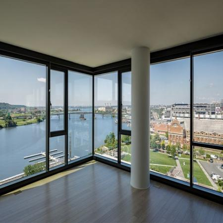 Floor to Ceiling Windows Overlooking the City and Waterway