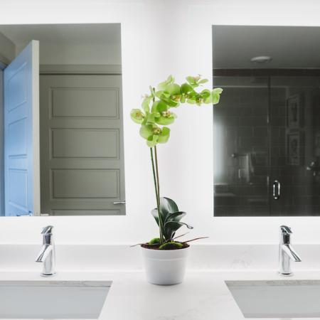 Bathroom dual vanity with back lit mirrors