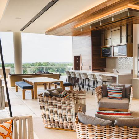 Outdoor resident lounge featuring kitchen and bar area and ample seating