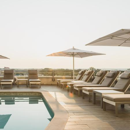 Rooftop pool with chaise lounge seating