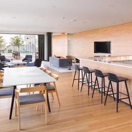 Resident lounge with long table, ample seating as well as a bar area