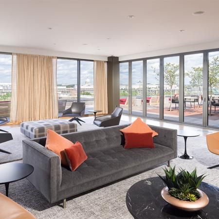 Resident lounge with wall of floor to ceiling windows