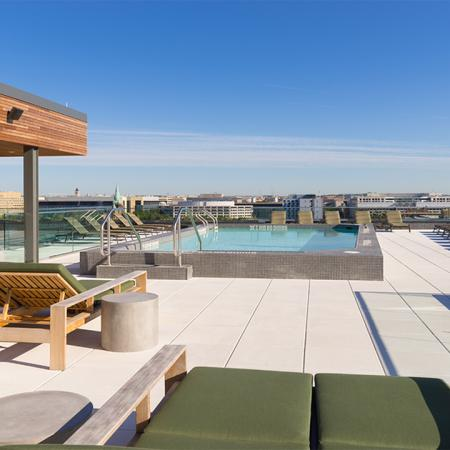 Rooftop pool with sundeck featuring chaise lounge seating