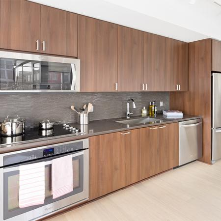Kitchen with stainless steel appliances and dark quartz counter tops