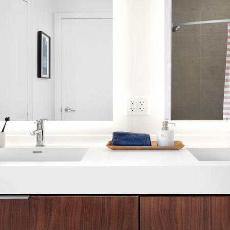 Dual Vanity with Quartz Counter-tops and Back-lit Mirrors