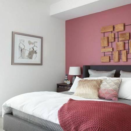 Guest Bedroom with Floor to Ceiling Window, Queen Bed, and Two Nightstands