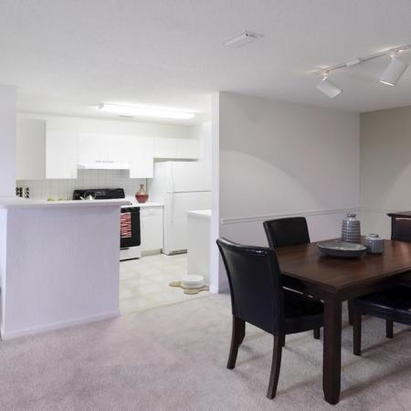 Brightly lit kitchen open to dining area