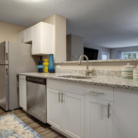 Kitchen open to dining and living areas
