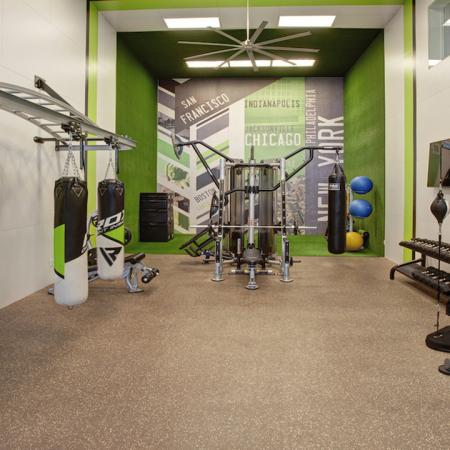 Brightly colored fitness studio with kickboxing equipment