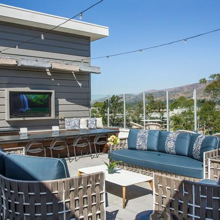 Resident Sun Deck with Seating, Bar, and Wall Mounted TV
