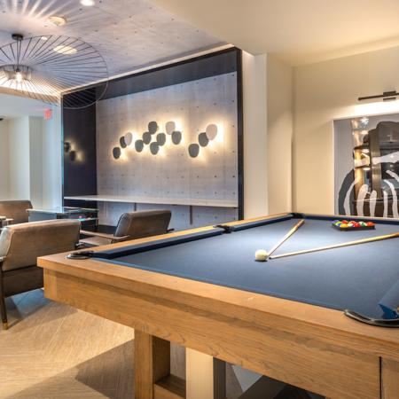 Pool table in resident lounge next to seating options