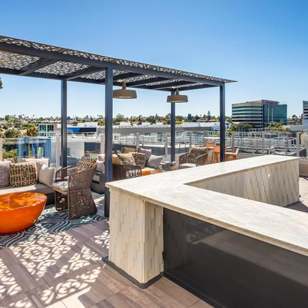 Spacious outdoor amenity space with cozy seating and a gorgeous view.