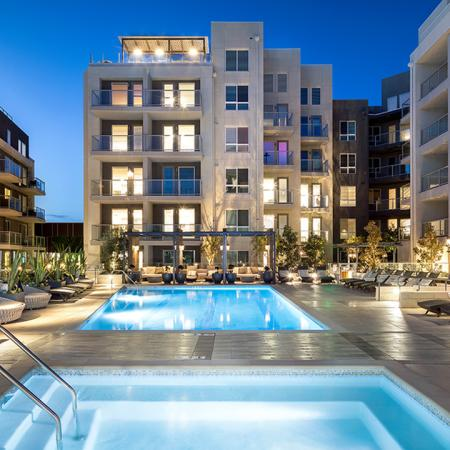 Large pool amenity space with seating.