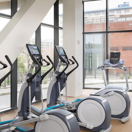 Fitness center with cardio equipment amongst floor to ceiling windows
