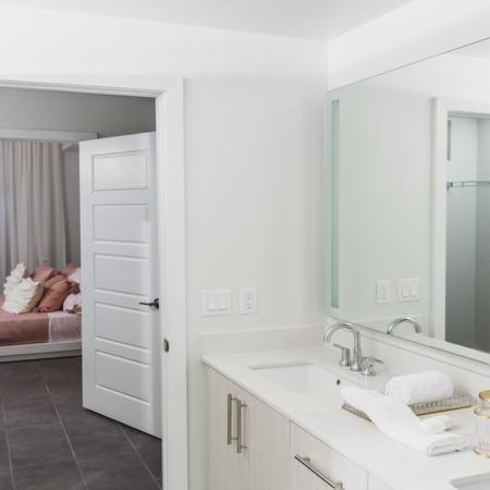 Large bedroom and bathroom with pass through and double vanities