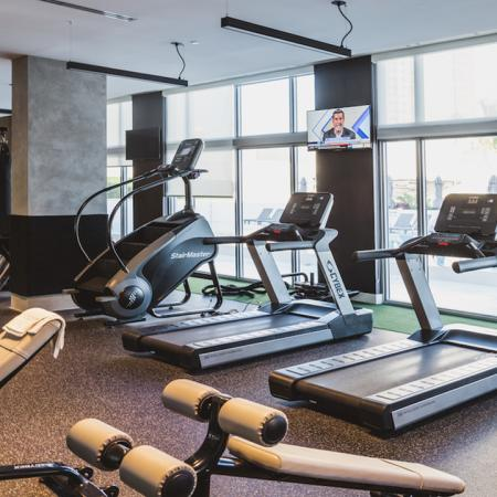 Treadmills, free weights, and stair-climber all featured in the fitness center