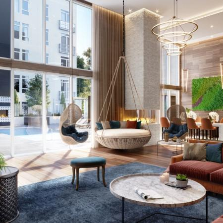 Rendering of a cozy, upscale clubroom with views of a pool.