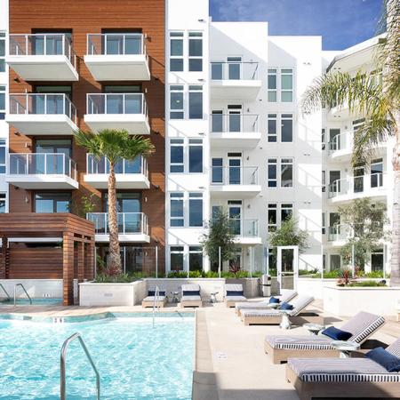 Community with balconies, pool, plenty of outdoor seating around the pool