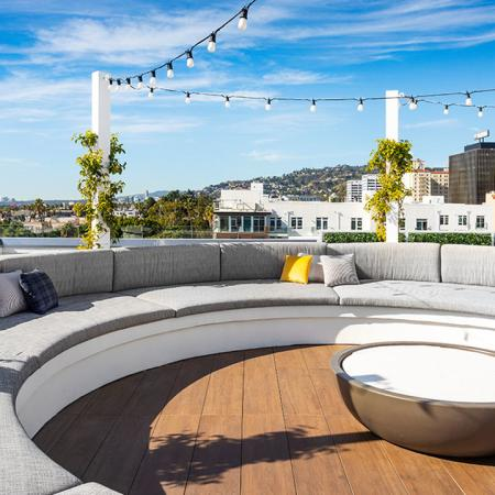 Rooftop lounge with expansive views and circular couch