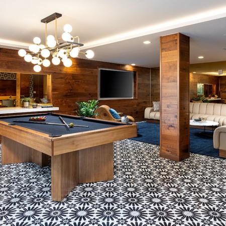 Pool table with quirky tiled floors in lounge area