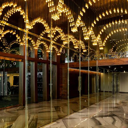 Lavish art deco lighting in the common areas making Modera Hollywood iconic living