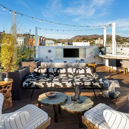 Seating on the rooftop with plenty of amenity space to host resident events