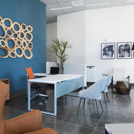 Chic Leasing Office with Concrete Flooring with Large Decorative Windows