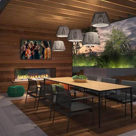 Rendering of roof top entertainment area featuring fireplace and long table