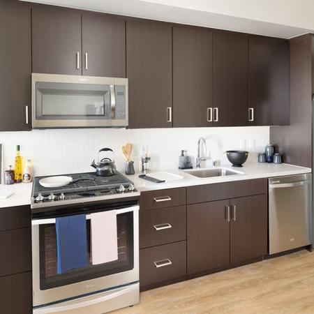 Stunning Kitchens with espresso custom cabinetry and stainless steel appliances