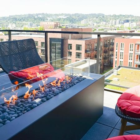 Firepit with views of Portland from Modera Bukman rooftop lounge
