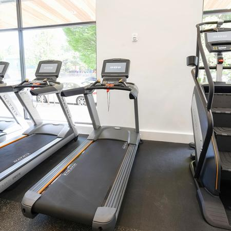 Treadmills and stairclimber machine in fitness center at Modera Buckman