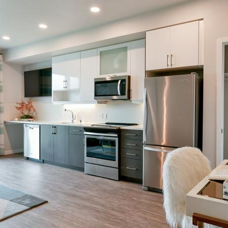 Stunning apartments with wood flooring, stainless steel appliances, and white cabinetry