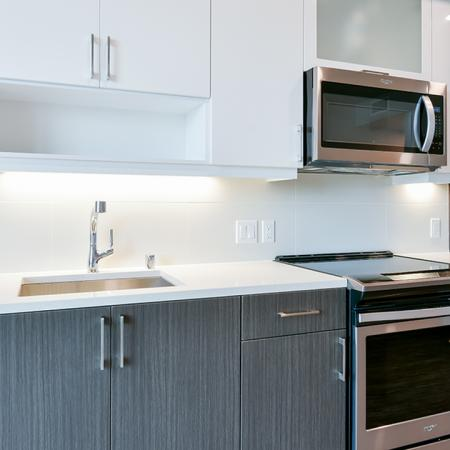 Kitchens feature tiled backsplash, USB ports and under cabinet lighting