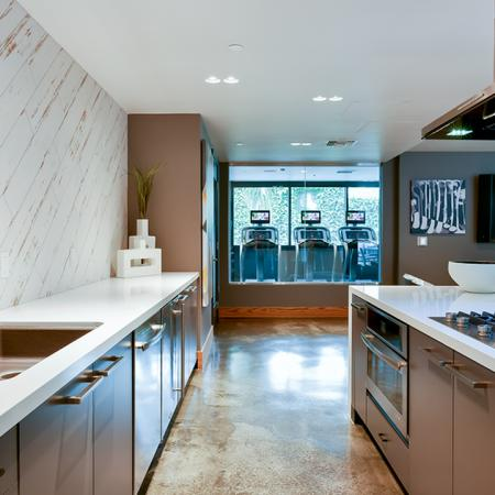 Galley chef-inspired kitchen in the resident lounge