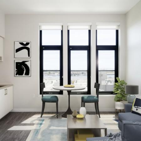 Homes with black windows, wood flooring, and blue sofa.