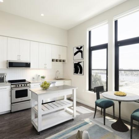 Stunning apartments with wood flooring, moveable storage, and stainless steel appliances.