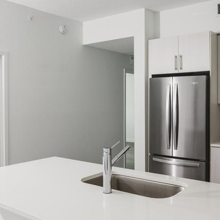 Open concept, modern kitchen with white cabinetry