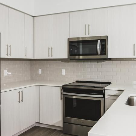Cream cabinetry, french door refrigerators and gorgeous tile back splash