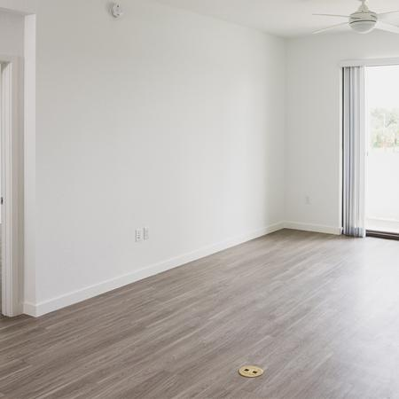 Living area with faux wood plank flooring