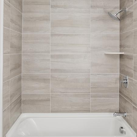 Curved shower rods, built in storage, and tub surrounds