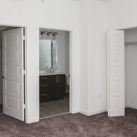 Ample storage space with walk-in closets and built-in shelving.