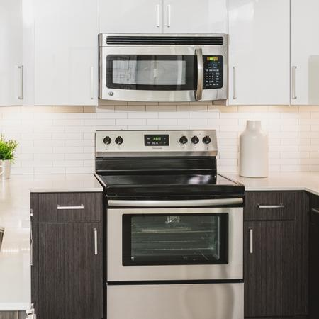 Upgraded kitchen with stainless range and microwave